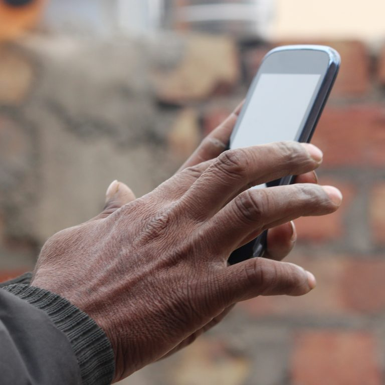 Man holding a mobile device.