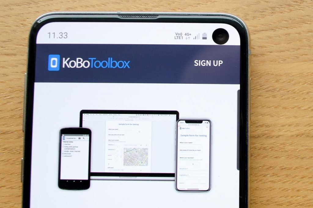 Mobile phone with KoBoToolbox website.
