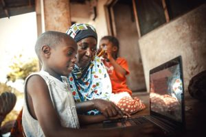 Photo of an African family on a laptop.