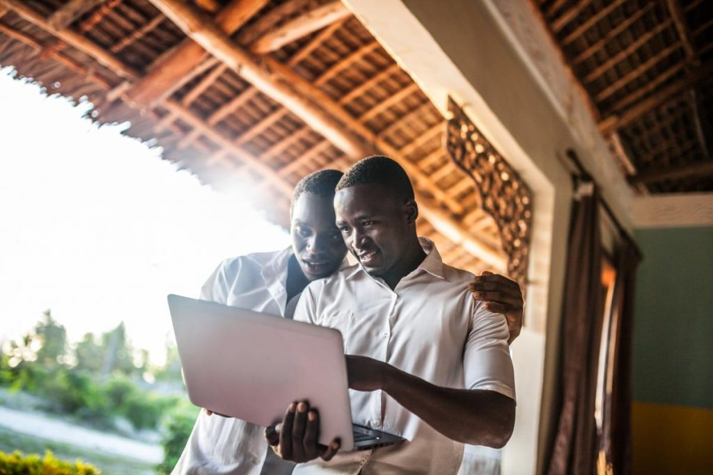 African teenagers using a laptop